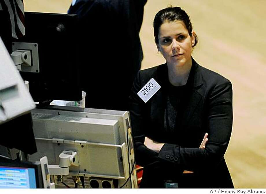 Elizabeth Millea of Bear Wagner Specialists looks at an overhead monitor from the floor of the New York Stock Exchange, Tuesday, July 8, 2008 in New York. Wall Street fluctuated Tuesday, with investors still jittery about the nation's ailing financial system but relieved to hear Federal Reserve chairman Ben Bernanke say the central bank might extend its lending efforts to investment banks. (AP Photo/Henny Ray Abrams) Photo: Henny Ray Abrams, AP