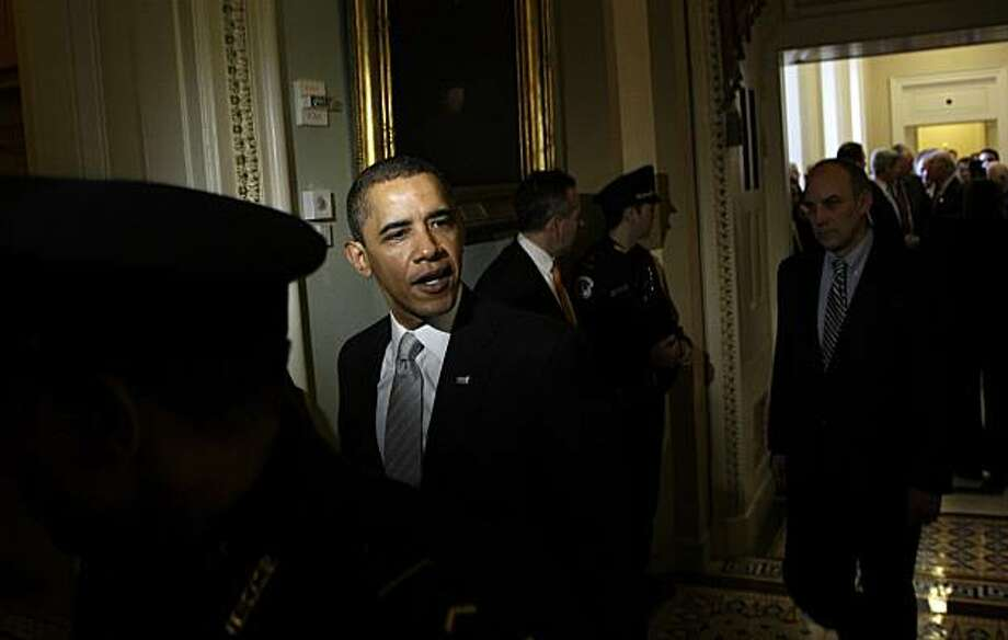 President Barack Obama responds to a question as he leavesthe Senate Democratic caucus on Capitol Hill in Washington Sunday, Dec. 6, 2009. The Senate is meeting in a rare Sunday session to debate health care overhaul. (AP Photo/Alex Brandon) Photo: Alex Brandon, AP