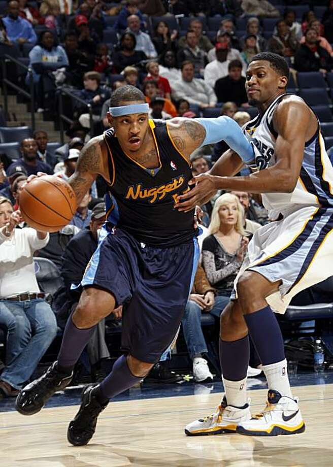 Denver Nuggets forward Carmelo Anthony, left, works against Memphis Grizzlies forward Rudy Gay in the second half of an NBA basketball game Sunday, Dec. 20, 2009, in Memphis, Tenn.  The Grizzlies defeated the Nuggets 102-96.  Anthony scored the game-high 41 points.  (AP Photo/Nikki Boertman) Photo: Nikki Boertman, AP