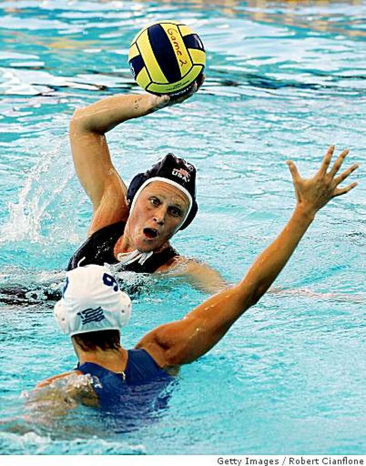 MELBOURNE, AUSTRALIA - MARCH 23:  Heather Petri of United States looks to shoot over Evangelia Moraitidou of Greece in the Women's Preliminary Round Group C Water Polo match between Greece and the United States of America at the Melbourne Sports & Aquatic Centre during day 7 of the Melbourne 2007 FINA World Championships on March 23, 2007 in Melbourne, Australia.  (Photo by Robert Cianflone/Getty Images) *** Local Caption *** Heather Petri;Evangelia Moraitidou Photo: Robert Cianflone, Getty Images