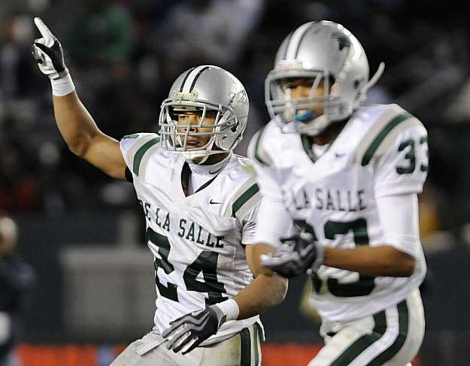 De La Salle's Tyler Anderson, left, and David Redmon celebrate after De La Salle scored a touchdown in the third quarter during the 2009 CIF Open Division State Bowl Game between De La Salle High School and Crenshaw High School at the Home Depot Center in Carson, Calif., on Saturday, Dec. 19, 2009. Photo: Carlos Delgado, Special To The Chronicle