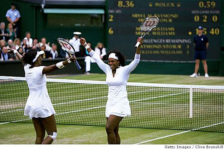 LONDON - JULY 05:  Venus Williams of United States and Serena Williams of United States celebrate match point and winning the women's doubles Final match against Lisa Raymond of United States and Samantha Stosur of Australia on day twelve of the Wimbledon Lawn Tennis Championships at the All England Lawn Tennis and Croquet Club on July 5, 2008 in London, England.  (Photo by Clive Brunskill/Getty Images) Photo: Getty Images