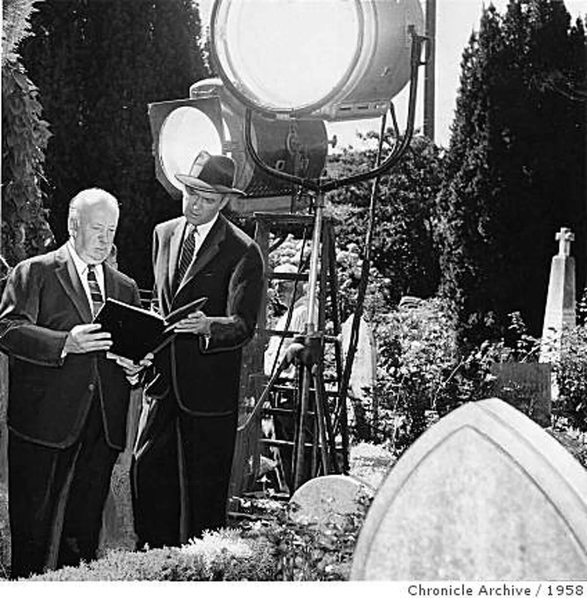 """Alfred Hitchcock and James Stewart during the filming of """"Vertigo"""" in 1958 at Mission Dolores, San Francisco"""