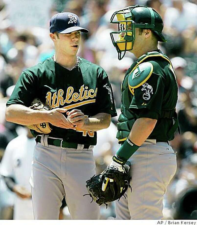 Oakland Athletics catcher Rob Bowen, right, talks with pitcher Rich Harden during the first inning of a baseball game in Chicago, Sunday, July 6, 2008. (AP Photo/Brian Kersey) Photo: Brian Kersey, AP