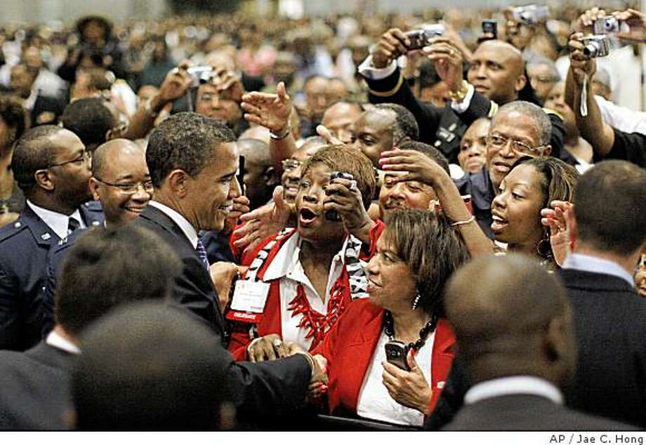 Democratic presidential candidate, Sen. Barack Obama, D-Ill, left, greets supporters at the 48th Quadrennial Session of the African Methodist Episcopal Church in St. Louis, Mo., Saturday, July 5, 2008. (AP Photo/Jae C. Hong) Photo: Jae C. Hong, AP