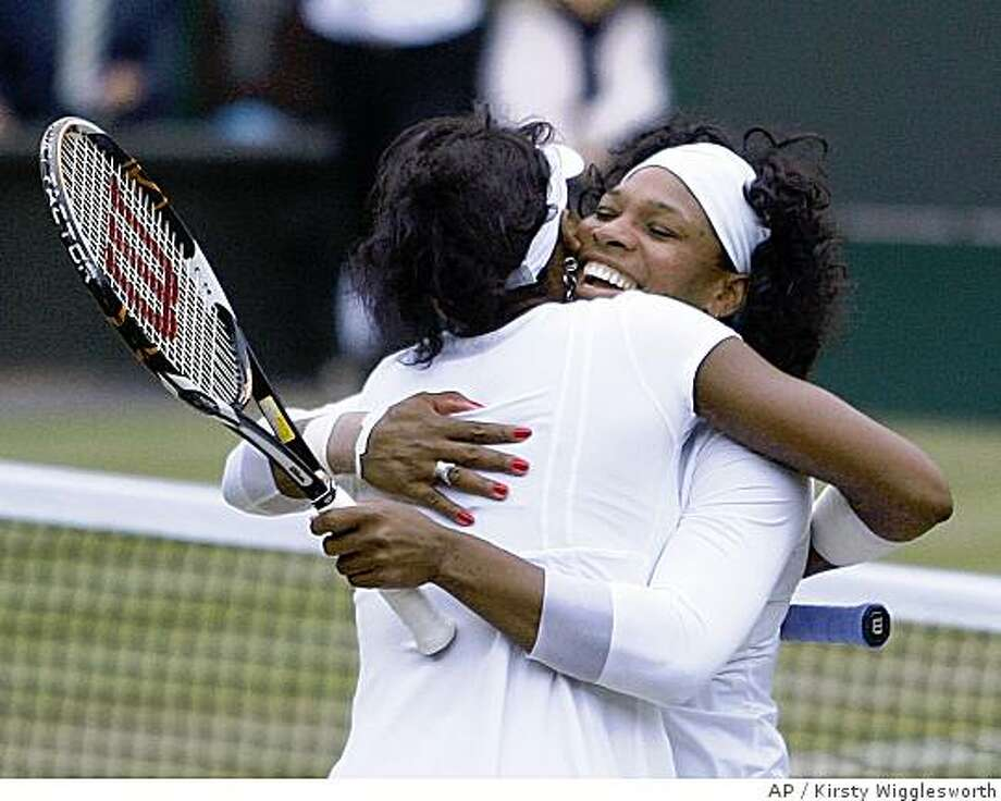 Serena Williams right, and her sister Venus embrace after their win in the Women's Doubles final against Australia's Samantha Stosur and Lisa Raymond of the US on the Centre Court at Wimbledon, Saturday, July 5, 2008. (AP Photo/Kirsty Wigglesworth) Photo: Kirsty Wigglesworth, AP