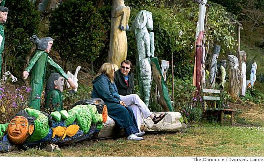 Visitors to Cayuga Park at 301 Naglee Street in San Francisco, Marilyn Rowand and Karl Breice sit on a fallen tree that's been carved by City Gardner Demetrio Braceros who just retired leaving the city with one of the more interesting neighborhood parks in the City.  Photographed Friday 4, July 2008 in San Francisco By Lance Iversen / The Chronicle Photo: Iversen, Lance, The Chronicle