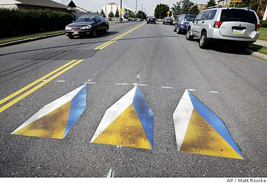 Shown is a three-dimensional image of speed bumps painted on a road in Philadelphia, Friday, June 20, 2008. (AP Photo/Matt Rourke) Photo: Matt Rourke, AP