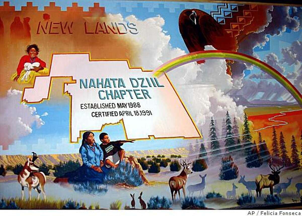 ** ADVANCE FOR WEEKEND EDITIONS, JUNE 28-29 ** A mural in the Nahata Dziil Chapter House of The Navajo community is shown in Sanders, Ariz. on May 22, 2008. More than 20 years ago, the federal government bought land here for thousands of Navajos who were relocated off land Congress said belonged to the Hopi tribe. It's different here than elsewhere on the Navajo Nation, all the roads are paved, schools and clinics are a short drive away, and everyone has electricity and running water. But the federal office that has provided for those conveniences is set to close, and some Navajos are arguing that it's too soon. (AP Photo/Felicia Fonseca)