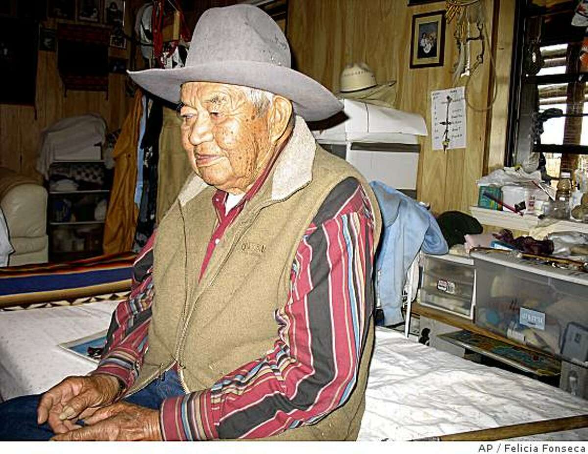 ** ADVANCE FOR WEEKEND EDITIONS, JUNE 28-29 ** Ram Herder, 89, is shown on May 22, 2008 in his Sanders, Ariz. home that was provided by the federal government as part of a massive relocation project to move Navajos from land Congress said belonged to the Hopi Tribe. It's different here than elsewhere on the Navajo Nation, all the roads are paved, schools and clinics are a short drive away, and everyone has electricity and running water. Now the federal office that has provided for those conveniences is set to close, and some Navajos are arguing that it's too soon. (AP Photo/Felicia Fonseca)