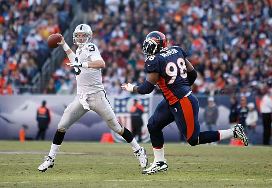 DENVER - DECEMBER 20:  Quarterback Charlie Frye #3 of the Oakland Raiders scrambles to get away from Ryan McBean #98 of the Denver Broncos in the first half at Invesco Field at Mile High on December 20, 2009 in Denver, Colorado. The Raiders defeated the Broncos 20-19. (Photo by Jeff Gross/Getty Images) Photo: Jeff Gross, Getty Images