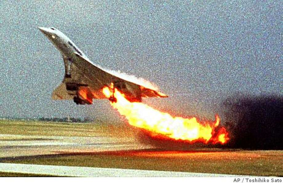 ** FILE **In this July 25, 2000, file photo, Air France Concorde flight 4590 takes off with fire trailing from its engine on the left wing from Charles de Gaulle airport in Paris. The plane crashed shortly after take-off, killing all the 109 people aboard and four others on the ground. A French judge ordered, Wednesday, July 2, 2008, Continental Airlines and five people to stand trial for manslaughter in connection with the 2000 crash of a Concorde jet that killed 113 people. (AP Photo/Toshihiko Sato, File) ** JAPAN OUT ** Photo: Toshihiko Sato, AP
