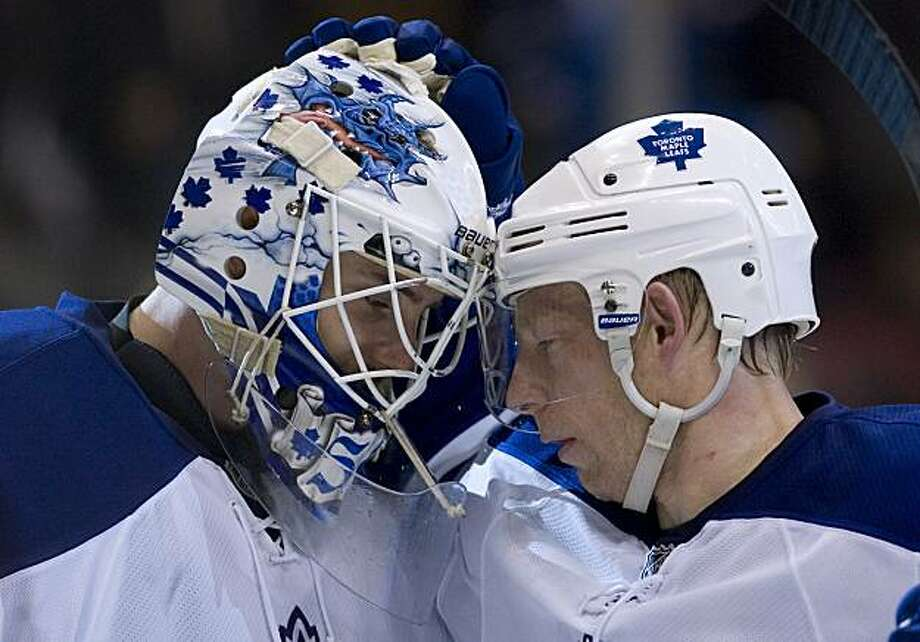 Toronto Maple Leafs goaltender Jonas Gustavsson, of Sweden, celebrates his first NHL shut out with goal scorer Jason Blake, right, after they beat  Boston Bruins 2-0 after the third period of an NHL hockey game in Toronto on Saturday, Dec. 19, 2009. (AP Photo/The Canadian Press, Chris Young) Photo: Chris Young, AP