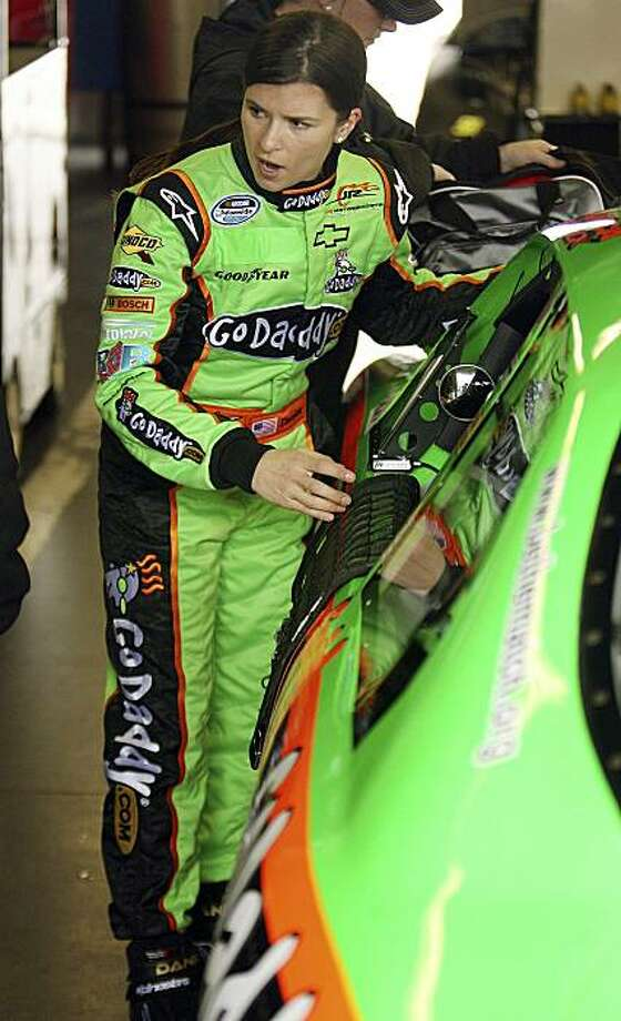 Danica Patrick prepares to get into her race car during testing for her new GoDaddy.com stock car at Daytona International Speedway in Daytona Beach, Fla., on Friday, Dec. 18, 2009. (AP Photo/Orlando Sentinel, Stephen M. Dowell) ** LEESBURG OUT; LADY LAKE OUT; TV OUT; MAGS OUT; NO SALES ** Photo: Stephen M. Dowell, AP