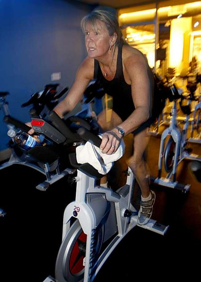 Tina Churich warms up before her daily spinning class at Equinox fitness club in San Mateo, Calif., on Wednesday, Nov. 25, 2009. Photo: Paul Chinn, The Chronicle