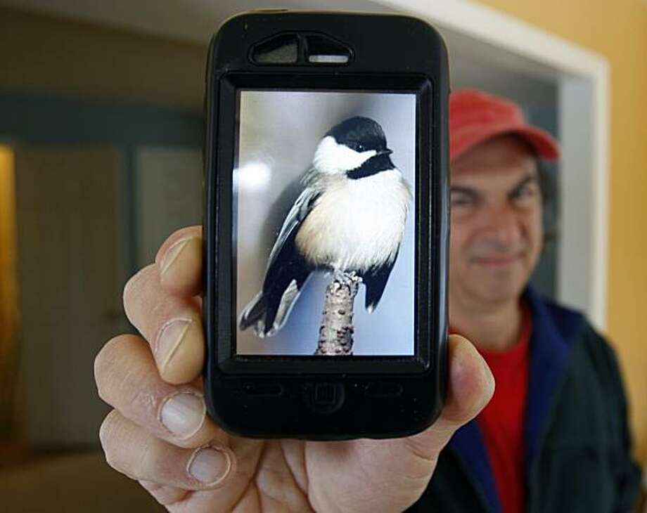 Jory Langner shows off the  BirdsEye application on his iPhone in Delmar, N.Y., on Tuesday, Dec. 8, 2009.  BirdsEye, recently released for iPhone and iPod Touch at a cost of $19.99, was developed through a collaboration of some of the top ornithologists in the country using content from the Cornell University Lab of Ornithology, the Academy of Natural Sciences and field guide author Kenn Kaufman.  (AP Photo/Mike Groll) Photo: Mike Groll, AP