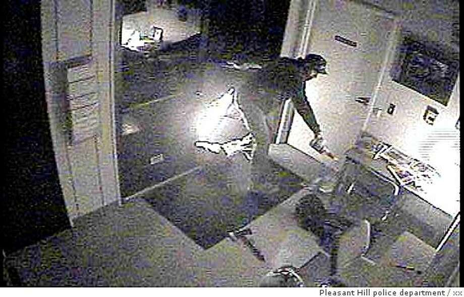 Surveillance camera photo of a man believed to have set fire to the Diablo Valley College police services building in Pleasant Hill on June 23. Photo: Xx, Pleasant Hill Police Department