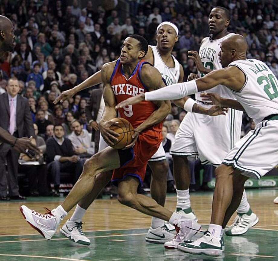 Philadelphia 76ers forward Andre Iguodala (9) drives to the basket through Boston Celtics' Ray Allen, right, Paul Pierce, rear left, and Kendrick Perkins, rear center, during the second half of their NBA basketball game in Boston, Friday, Dec. 18, 2009. The 76ers beat the Celtics 98-97. (AP Photo/Charles Krupa) Photo: Charles Krupa, AP