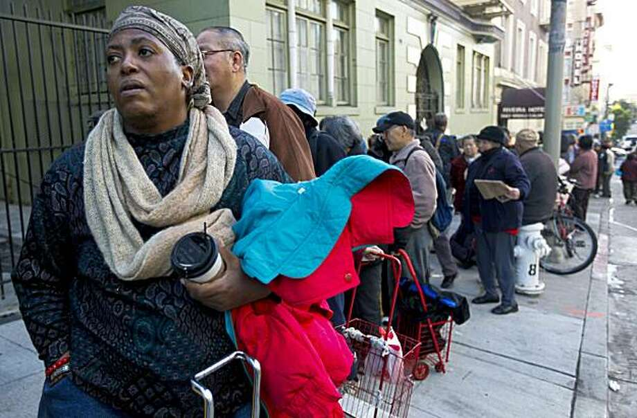 Frances Madison, joins a line that stretches around the block during Glide Memorials annual grocery giveaway to needy people, in San Francisco, Ca., on Friday December 18, 2009. Photo: Michael Macor, The Chronicle