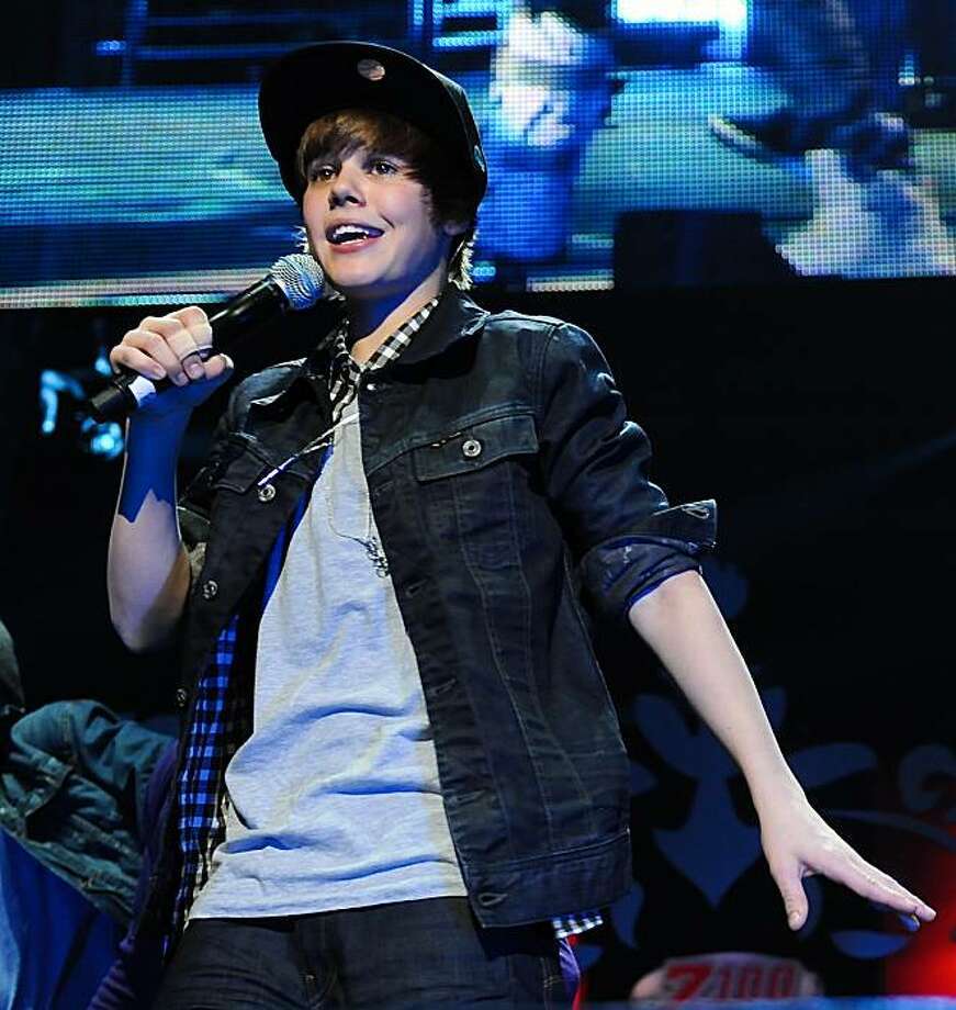 Singer Justin Bieber performs at the 2009 Z100 Jingle Ball at Madison Square Garden in New York on Friday, Dec. 11, 2009. (AP Photo/Evan Agostini) Photo: Evan Agostini, AP