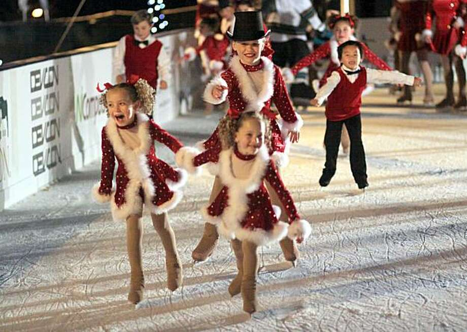 Young skaters from the Sharks Ice Learn To Skate program performing in Pleasanton earlier this month.  An Oakland-based group of students from this program will perform in a holiday show at the Oakland Ice Center this weekend. Photo: Courtesy San Jose Sharks/SVSE