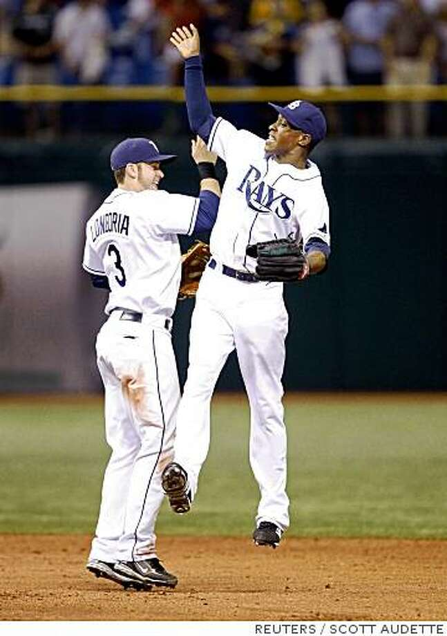Tampa Bay Rays' Evan Longoria (L) and B.J. Upton celebrate their victory over the Boston Red Sox following their American League baseball game in St. Petersburg, Florida July 1, 2008.    REUTERS/Scott Audette (UNITED STATES) Photo: SCOTT AUDETTE, REUTERS