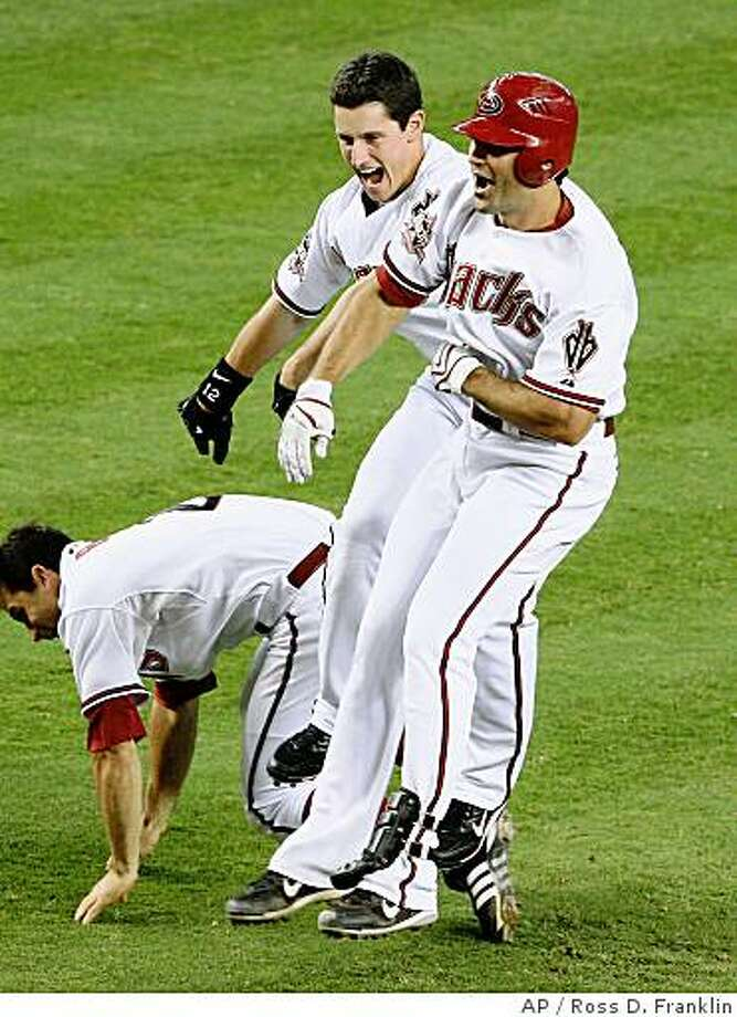 Arizona Diamondbacks' Conor Jackson, right, who got the game-winning hit against the Milwaukee Brewers, celebrates with teammates Jeff Salazar, center, and Chris Burke after a baseball game Thursday, July 3, 2008, in Phoenix. The Diamondbacks defeated the Brewers 6-5, scoring all six of their runs in the ninth inning. (AP Photo/Ross D. Franklin) Photo: Ross D. Franklin, AP