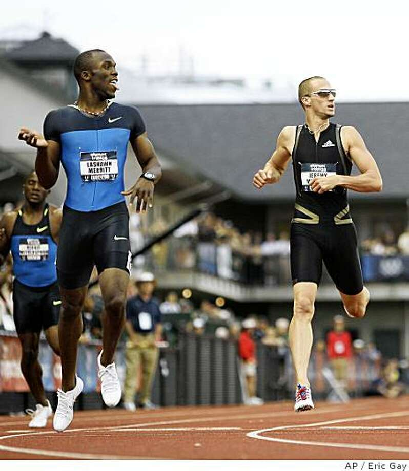 LaShawn Merritt, left, crosses the finish line before Jeremy Wariner in the men's 400 meter final at the U.S. Olympic Track and Field Trials in Eugene, Ore., Thursday, July 3, 2008.  (AP Photo/Eric Gay) Photo: Eric Gay, AP