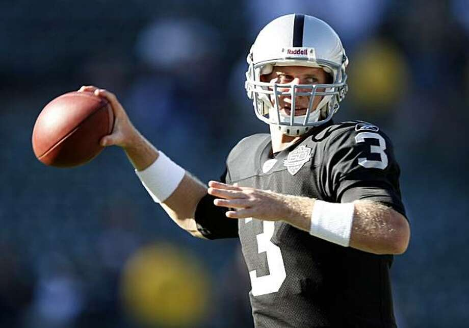 Oakland Raiders quarterback Charlie Frye warms up against the Dallas Cowboys before a preseason NFL football game in Oakland, Calif. Frye will start at quarterback over former starter JaMarcus Russell when the Raiders visit the Denver Broncos on Sunday. Coach Tom Cable said in a conference call on Wednesday with Denver media that Russell will be his No. 2 quarterback, with the newly signed J.P. Losman third. Photo: Marcio Sanchez, AP