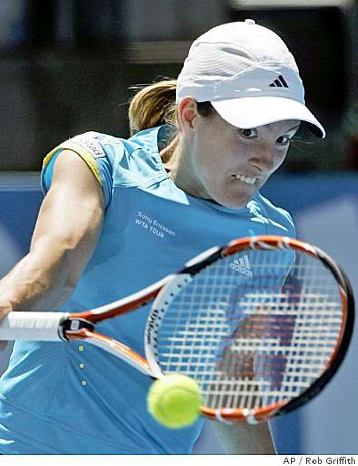 Belgium's Justine Henin plays a shot in her match against Ana Ivanovic of Serbia at the Sydney International tennis  in  Sydney, Australia, Thursday, Jan. 10, 2008. Henin won the match 6-2, 2-6, 6-4. (AP Photo/Rob Griffith) Photo: Rob Griffith, AP