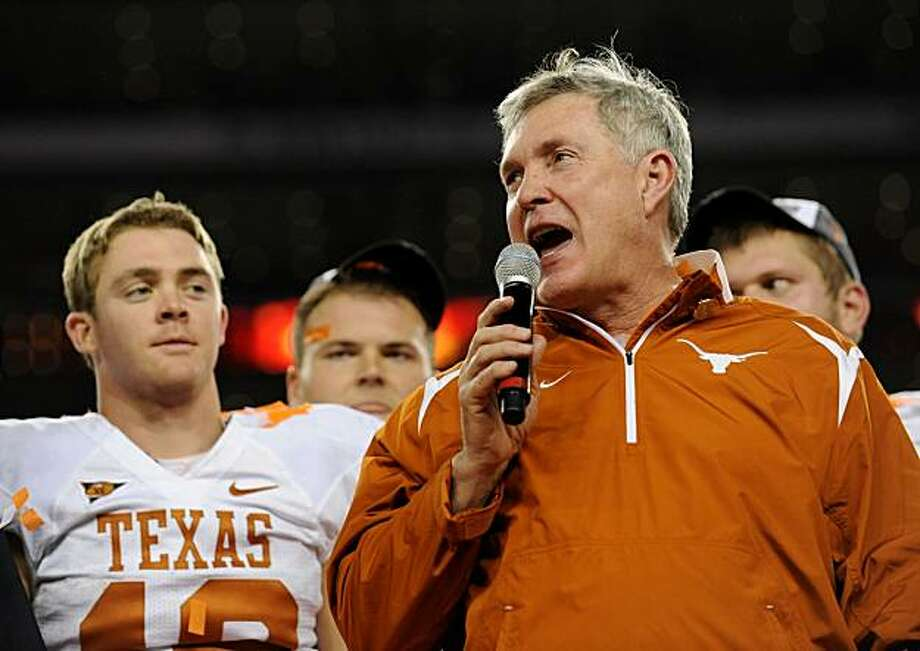 ARLINGTON, TX - DECEMBER 5: Head coach Mack Brown of the Texas Longhorns celebrates speaks to the crowd with quarterback Colt McCoy #12 after their team won the game 10-6 over the Nebraska Cornhuskers at Cowboys Stadium on December 5, 2009 in Arlington, Texas. (Photo by Ronald Martinez/Getty Images) Photo: Ronald Martinez, Getty Images