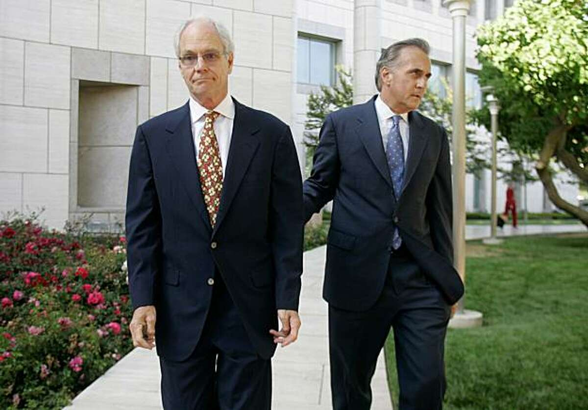 FILE - In this June 5, 2008 file photo, Broadcom's former chief financial officer, William J. Ruehle, left, and his attorney Richard Marmaro leave the Ronald Reagan Federal Courthouse in Santa Ana, Calif. A federal judge will consider Tuesday, Dec. 15, 2009, whether allegations of prosecutorial misconduct are serious enough to warrant throwing out a fraud and conspiracy case against Ruehle. (AP Photo/The Orange County Register, Mindy Schauer) ** NO SALES, MAGS OUT, LA TIMES OUT **