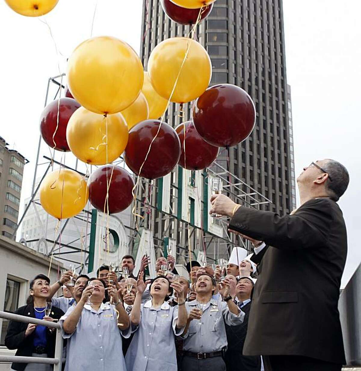 Clem Esmail General Manager of the Palace Hotel in San Francisco released a balloon that has the key to the Presidential suite in front of long term employees, marking the 100th anniversary of the hotel. Tuesday Dec 15, 2009
