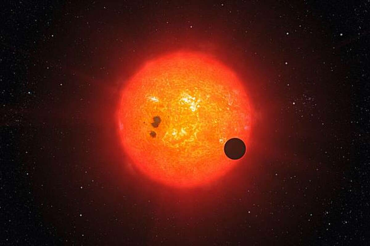 An artist's rendering of a second super-Earth exoplanet for which astronomers have determined the mass and radius. The planet, which orbits a dim red star about 40 light-years away from the Earth, is extremely hot and probably cloaked in a crushing atmosphere, astronomers said Wednesday, Dec. 16, 2009. (L. Calcada/European Southern Observatory) **EDITORIAL USE ONLY; MAGS OUT/NO SALES; FOR USE ONLY WITH STORY SLUGGED SAUNA-PLANET BY DENNIS OVERBYE; ALL OTHER USE PROHIBITED**
