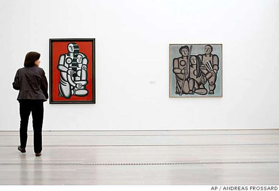 "** FILE ** In this Friday, May 30, 2008 file photo, a visitor looks at ""Les Deux Figures"", left, and ""Les Trois Personnages"", right, at the Fernand Leger exhibition ""Paris-New York"" at the Fondation Beyeler in Riehen, Switzerland. The exhibition, which runs through Sept. 9, 2008, covers the key phases of the work of Leger, one of the principal figures in the revolutionary cubist art movement. (AP Photo/KEYSTONE, Andreas Frossard, file) Photo: ANDREAS FROSSARD, AP"