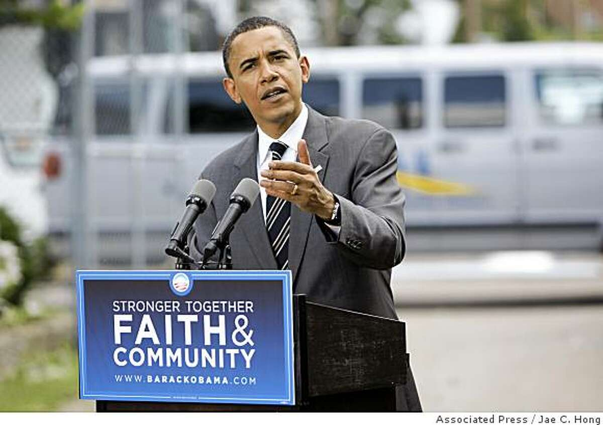 Democratic presidential candidate, Sen. Barack Obama, D-Ill., speaks during a news conference after he toured the East Community Ministry in Zanesville, Ohio, Tuesday, July 1, 2008. (AP Photo/Jae C. Hong)