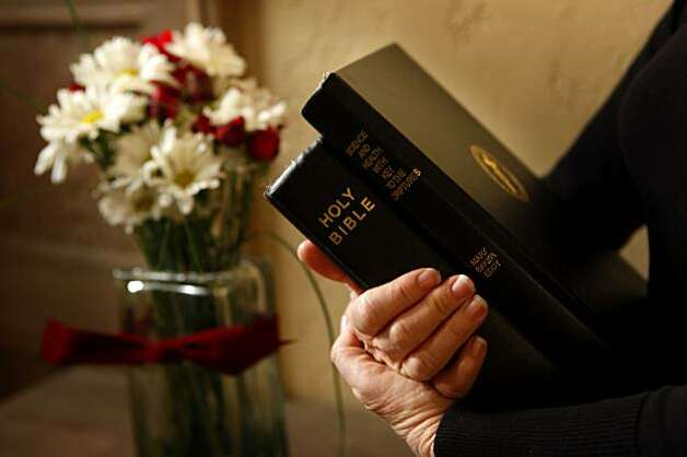 Susan Breuer, a Christian Science practitioner, studies form both the Bible and Science testbook by Mary Baker Eddy,  Thursday Dec. 17, 2009, at her home in San Mateo, Calif. Photo: Lacy Atkins, The Chronicle