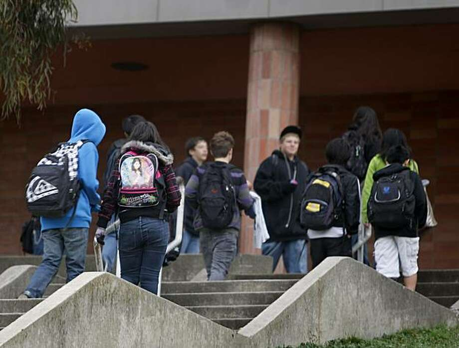 Students arrive for classes at Portola Middle School in El Cerrito, Calif., on Tuesday, Dec. 15, 2009. Authorities have arrested a 14-year-old student after he allegedly raped a 12-year-old schoolmate in a stairwell on campus last week. Photo: Paul Chinn, The Chronicle