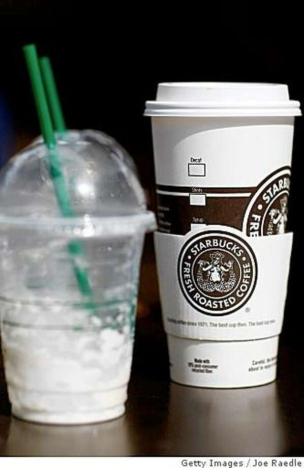 WEST PALM BEACH, FL - JULY 1:  Starbucks drinks sit on a table outside a store on the day that Starbucks Corp. said that it plans to close 600 company-operated stores in the United States July 1, 2008 in West Palm Beach, Florida. The company said the job cuts with the store closings represent about 7 percent of Starbucks' global workforce.  (Photo by Joe Raedle/Getty Images) Photo: Joe Raedle, Getty Images