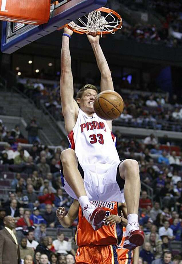 Detroit Pistons forward Jonas Jerebko (33), of Sweden, dunks on Golden State Warriors forward Anthony Randolph during the fourth quarter of an NBA basketball game in Auburn Hills, Mich., Saturday, Dec. 12, 2009. (AP Photo/Carlos Osorio) Photo: Carlos Osorio, AP