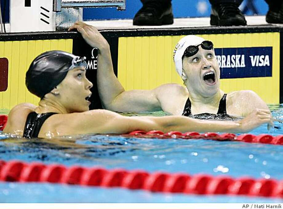 Katie Hoff, right, reacts to her winning time as Natalie Coughlin looks on after the women's 200-meter individual medley final at the US Olympic swimming trials in Omaha, Neb., Wednesday, July 2, 2008. (AP Photo/Nati Harnik) Photo: Nati Harnik, AP