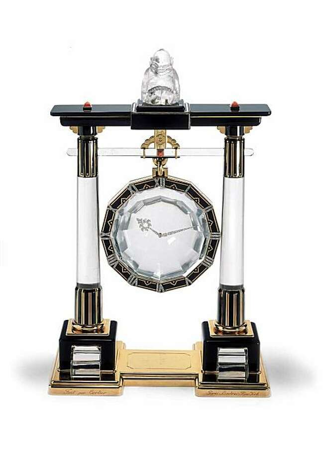 Cartier, Paris, 1923, Large Portique Mystery Clock, platinum, gold, rock crystal (dial, columns, and Biliken figure), rose-cut diamonds, coral cabochons, onyx, and black enamel.  Nick Welsh, Cartier Collection, © Cartier CM09A23 Photo: Nick Welsh, Cartier Collection