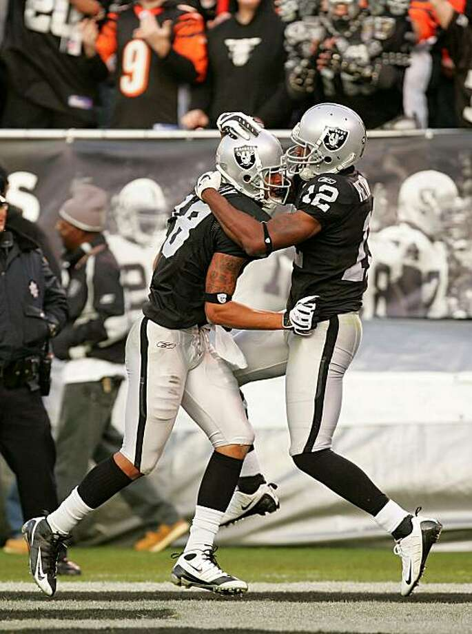 OAKLAND, CA - NOVEMBER 22:  Louis Murphy #18 of the Oakland Raiders is congratulated by Darrius Heyward-Bey #12 after Murphy scored the tying touchdown against the Cincinnati Bengals at Oakland-Alameda County Coliseum on November 22, 2009 in Oakland, California.  (Photo by Ezra Shaw/Getty Images) Photo: Ezra Shaw, Getty Images
