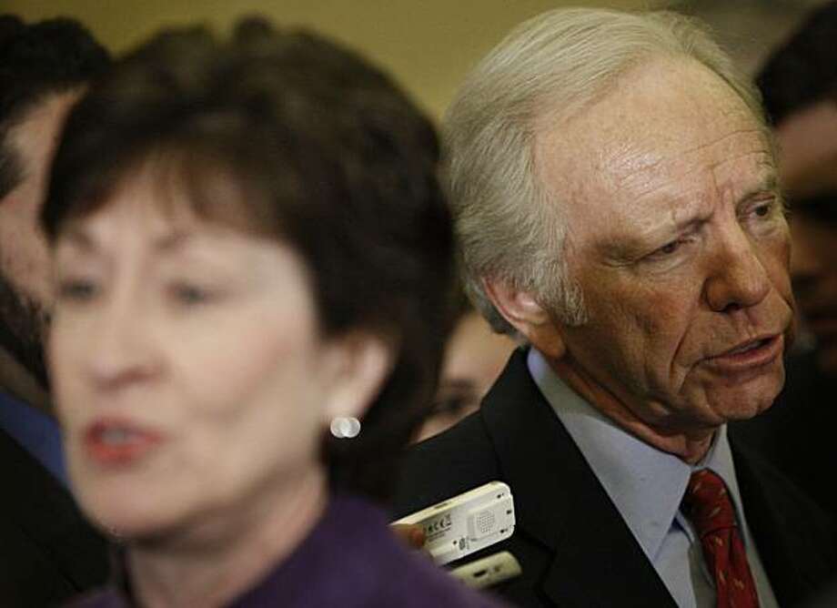 Sen. Joseph Lieberman, I-Conn., right, and Sen. Susan Collins, R-Maine, speak to members of the media on Capitol Hill in Washington, Tuesday, Dec. 15, 2009. (AP Photo/Pablo Martinez Monsivais) Photo: Pablo Martinez Monsivais, AP