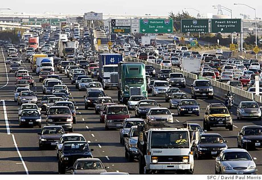 Traffic on roads like Highway 80 in Berkeley is behind about half of the Bay Area's output of greenhouse gases. Better gas mileage and public transit could reduce that. Photo: David Paul Morris, SFC