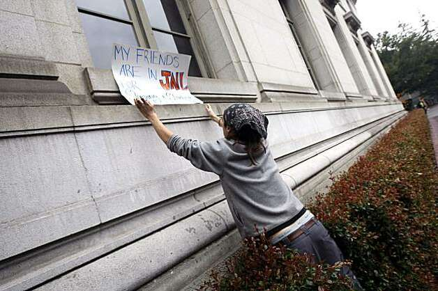 Dan Scott places his protest sign on a window ledge of the chancellor's offices in California Hall Friday Dec 11, 2009. The students are protesting the arrest of 65 fellow students that had occupied Wheeler Auditorium until an early raid. Photo: Lance Iversen, The Chronicle