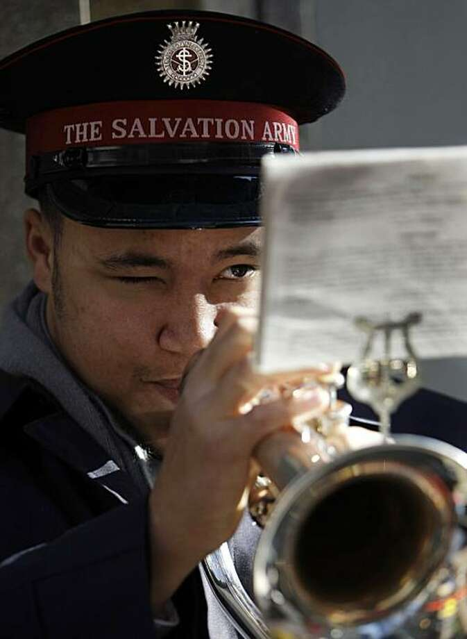 Salvation Army cadet Daniel Simmons plays Christmas carols on his bugle outside Macy's department store Friday, Nov. 27, 2009 in Chicago. Shoppers around the nation crowded stores and malls on Black Friday, the traditional start of the holiday shopping season. (AP Photo/Charles Rex Arbogast) Photo: Charles Rex Arbogast, AP