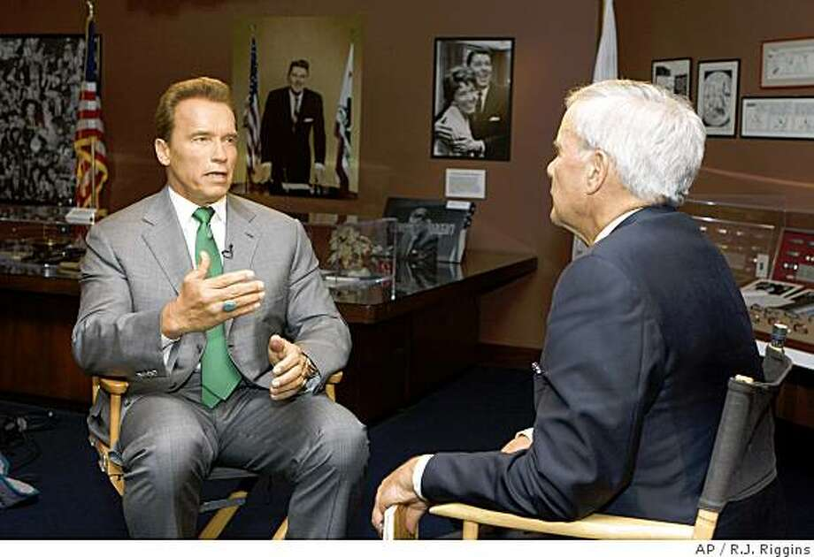 """** NO SALES, NO ARCHIVES, MUST USE BEFORE SUNDAY, JULY 6, 2008, MANDATORY CREDIT ** In this photo provided by Meet The Press, California Governor Arnold Schwarzenegger, left, is interviewed by moderator Tom Brokaw on """"Meet the Press"""" Tuesday, June 24, 2008 at the Ronald Reagan Presidential Library in Simi Valley, California. After the unexpected death of the former host Tim Russert, Tom Brokaw will be moderating """"Meet the Press"""" through the 2008 presidential election in November.  (AP Photo/ Meet the Press, R.J. Riggins) Photo: R.J. Riggins, AP"""