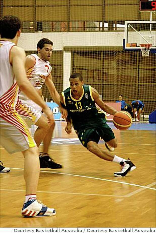 Patty Mills, St. Mary's basketball star, played for Australia's U19 team, the Emus, at the 2007 world championships in Serbia. He's shown here against Spain. Mills will play on the Australian Olympic team at the 2008 Beijing Olympics. Photo: Courtesy Basketball Australia