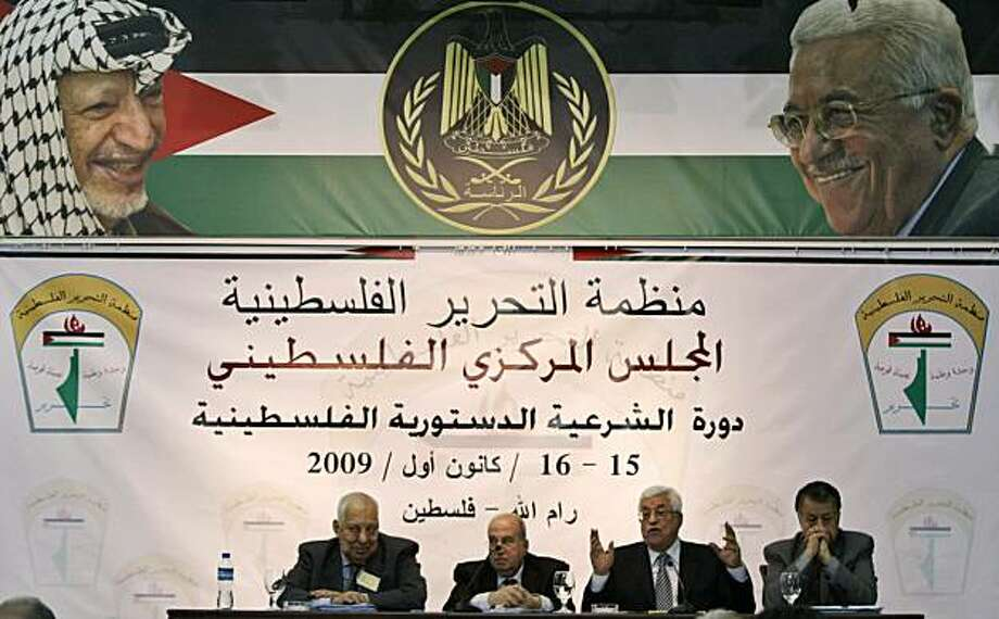 "Palestinian President Mahmoud Abbas, second right, gestures as he addresses a meeting of the Central Committee of the Palestine Liberation Organization (PLO) in the West Bank city of Ramallah, Tuesday, Dec. 15, 2009. Banner reads in Arabic: ""Palestinian Liberation Organization, the Palestinian National Council."" (AP Photo/Majdi Mohammed) Photo: Majdi Mohammed, AP"
